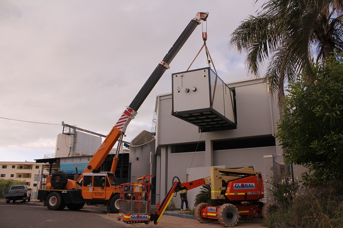 The thermal energy storage unit gets craned into the plant room on level one of Reef HQ Aquarium